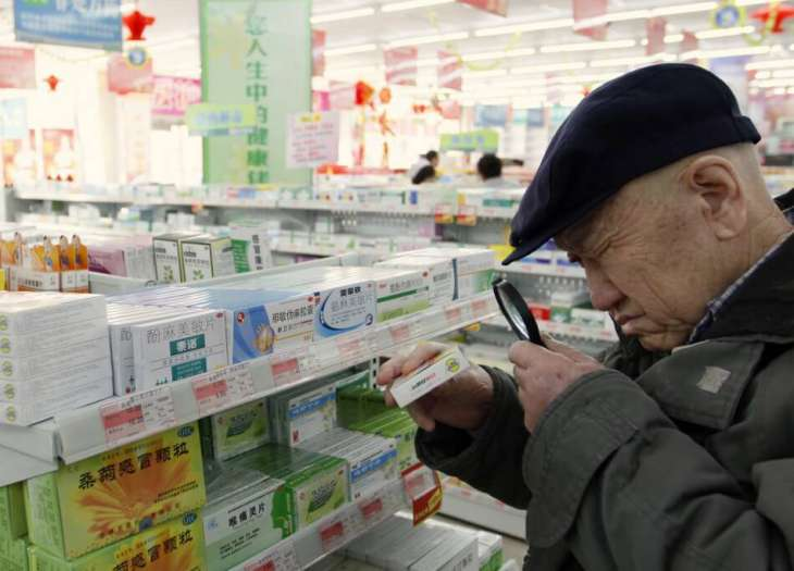 man shopping for modalert brand modafinil at a pharmacy in beijing china